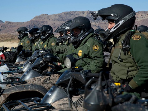 Border Patrol agents line up in formation on motor bikes in the Tucson sector.